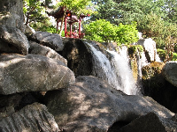 Wonderful rocks, waterfall, and pagoda.