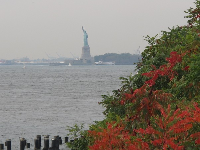 The Statue of Liberty, as seen from Brooklyn Bridge Park.