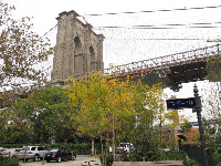 The River Cafe sits below the Brooklyn Bridge, as seen in the autumn.