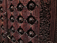 Ornate carved wooden door to the chapel.