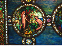 A sweet, little scene of Adam and Eve in stained glass.