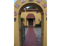 Archway to the yellow house.