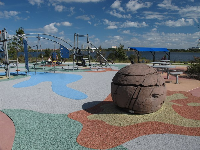Spherical rock in the middle of the playground.