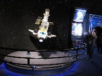Satellite in space shuttle payload bay exhibit.