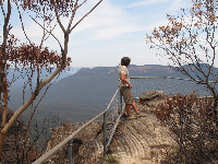 A man enjoys views across the Jamison Valley, from Tarpeian Rock Lookout.