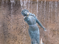 Mermaid with waterfall behind.