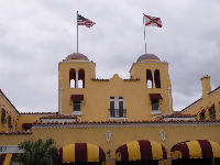 The yellow Colony Hotel with its Mediterranean twin domes and striped awnings.