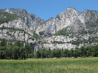 Yosemite Falls, seen from a meadow.