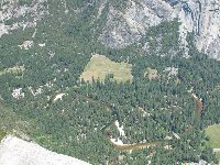 See the Merced River winding through Yosemite Valley, from Glacier Point Lookout.