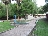 Concession area with showers and picnic tables with umbrellas.