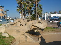 The dragon, and cafes in the background.