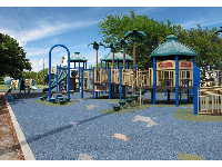 The large, colorful playground with tropical theme.