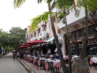 Outdoor seating at a restaurant on Espanola Way.