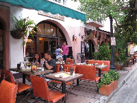Young couple dining at Espanola Way.
