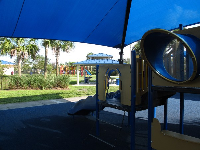 The shaded play structure and gazebo in the background.