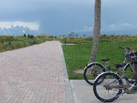 The wide brick path and Deco Bike station at South Pointe Park.