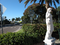 Statue with roundabout traffic behind.