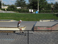 A skater does a trick at the skate park.