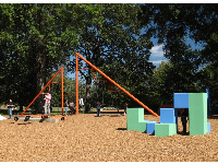 Giant blocks to climb, swings under triangle, and seesaws.