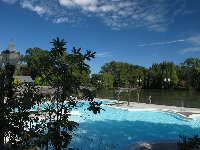 The aquatic center is situated beautifully on a lake.