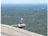 Boy on top of the world. I don't think I'd let my child do this...