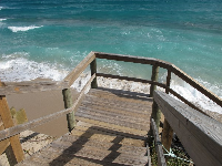 High surf, with waves washing up under the stairs!