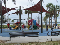 Playground under shade canopies at Lakefront Park.
