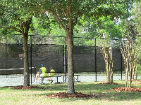 Father and son taking a break from tennis.