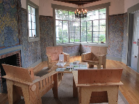 The painted room where you can sit on wooden chairs and read art books.