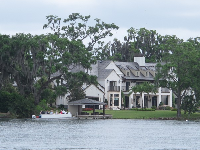 The scenic boat tour takes you past mansions on Lake Virginia and Lake Osceola.