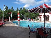 The attractive red and white horse-racing themed pool at Saratoga Springs Resort.