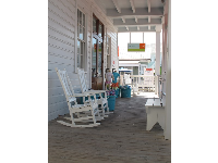 White rocking chairs outside Seaside Kids clothing shop.