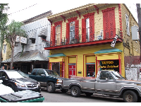 Red and yellow historic building on Frenchmen Street.