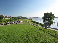The riverfront park that runs south of the sloped roof.