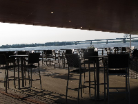 Waterfront outdoor seating under the sloped roof at Riverfront Bar and Grill.