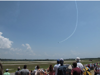 Onlookers watch the Blue Angels swoop down from the sky.