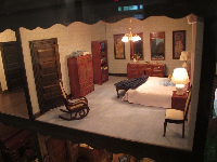 Incredibly lifelike bedroom in a doll house.