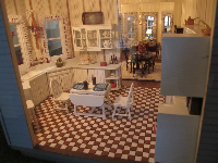 Doll house kitchen with checkered floor.