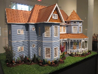 Pale blue Victorian doll house by Aaron Friedman.