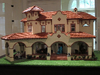 Spanish doll house with red tile roof, by Aaron Friedman.