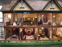The adorable rooms in a doll house by Aaron Friedman.