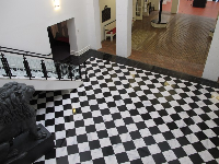 Black and white checkered floor and lion statue in the lobby.