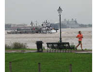 Jogger by the river, as seen from Washington Artillery Park.