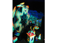 Glow-in-the-dark carousel scene in Fairyland Caverns.