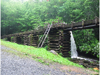 The flume that leads down to the mill's turbine.