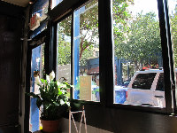 You can look out big windows at the street from Izzy's Coffee Den.