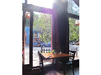 Look out the huge windows while you eat yummy food at Mela Indian Restaurant.