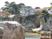 Wonderful views of houses and cypress trees on the cliff.