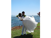 Japanese bride and groom being photographed at Magic Island.