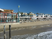 Looking back on the beach, Kincaid's Restaurant, and the office buildings, from the pier at King Harbor.